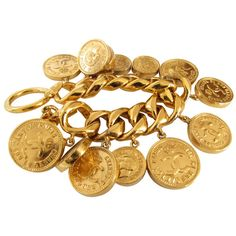 Pre-owned COCO-money - vintage CHANEL charm bracelet - bracelet with... ($1,600) ❤ liked on Polyvore featuring jewelry, bracelets, accessories, chanel, jewels, gold, gold coin bracelet, gold bracelet, gold crown and gold jewelry
