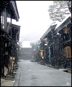 Early morning snow over one of the old streets of Takayama City, Gifu prefecture, Japan.