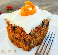 The Best Carrot Cake Ever with Cream Cheese Frosting...Moist, delicious and full of carrots and walnuts, the cinnamon gives it a warm spicy flavor.  The cream cheese