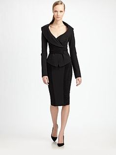 Saks Fifth Avenue.  Donna Karan, Jersey Off-The-Shoulder Jacket, $1295. Jersey Pencil Skirt. $850. Ms. Karan has a talent for recreating old Hollywood glamour in her designs, while giving them a chic, modern twist.
