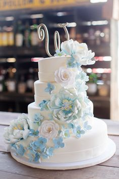 Cascading blue flower wedding cake {Photo by Erin Lindsey Images via Project Wedding}