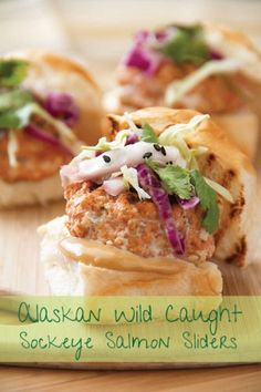 This recipe for salmon sliders is made with wild Alaskan sockeye salmon spiced with Asian flavors and served with a spicy slaw.