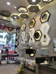 Sanitaryware # display # wash basins # wall # ceiling display # showroom # backdrop#unique#trendy#modern.
