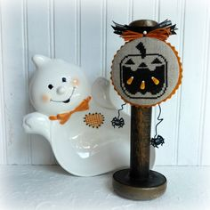 by SnowBerryNeedleArts Halloween Pumpkins, Halloween Decorations, Pumpkin Ornament, Wood Spool, Felt Cover, Halloween Cross Stitches, Cross Stitch Finishing, Autumn, Fall