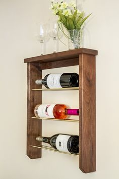 This DIY Wood And Brass Wine Rack is the perfect home accessory for the wine lover. (Mom would sure love it too as a handmade Mother's Day gift!)