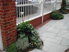 Brick and vinyl fencing