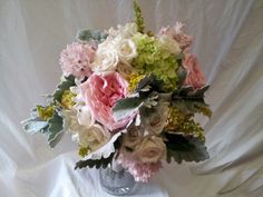 Bride's bouquet w/ white roses, pink roses, green hydrangeas, and dusty miller accent