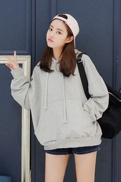 - pink cap - large over sized white pullover hoodie - dark denim shorts - black backpack