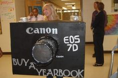 Not layout or design, but would be a cute way to advertise yearbooks being sold. Very cool idea to sell yearbooks. But it should be a Nikon not canon because our yearbook uses Nikon.