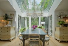 Cottage Dining Room with Chandelier, Laminate floors, Skylight, Exposed beam, PRI 3 Drawer Bombe Chest