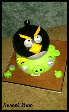 Angry Birds - Angry Birds cake for my nephew Travis. Top tier is a special cake mix that he can have that is free of his food allergens. Bottom tier is a vanilla funfetti cake. Both filled and iced with chocolate buttercream and covered in mmf. I unfortunately did not get the best photos of this cake with my cell phone, but nonetheless here it is. TFL!