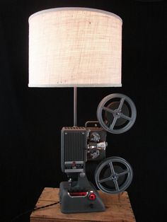 Upcycled Kodak 16mm Projector Lamp with Ivory Burlap Shade; why not put film around the outside of the shade?