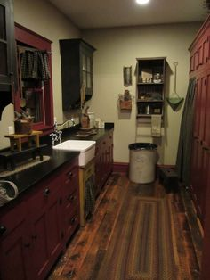 Like the 3 different paint color idea on the cabinets.
