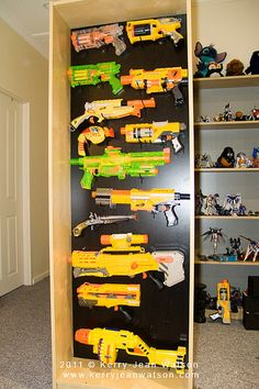 It's much easier (and cheaper) to affix the peg board directly to a wall using a 1x2 as a spacer.  With 2 boys I HAVE to figure out a way to organize all the toy weapons...any other ideas?!