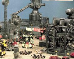 I love how so many battles of the Horus Heresy were fought around industrial complexes on desert planets! Awesome inspiration for 30k terrain project.