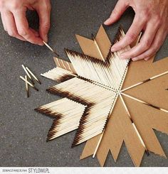 Burnt wooden matches glued to cardboard