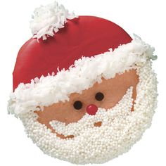 """Everyone knows that Santa Claus loves cookies, and he's sure to love these Cute Santa Cookies for Christmas! Decorated to look like the big man himself, these sweet holiday cookies are sure to get you in the Christmas spirit. Homemade Christmas cookies make great gifts for family and friends, and leaving some of these cookies out for Santa on Christmas Eve is sure to get you on the """"nice list""""!"""