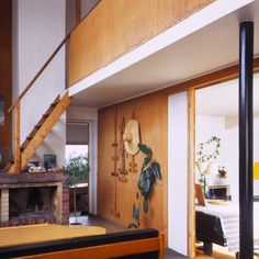 A small mezzanine on the second floor creates a corridor underneath that leads into several smaller spaces from the main room. Designed by Alvar Aalto, Alvar Aalto's home, located in Munkkiniemi area in Helsinki.