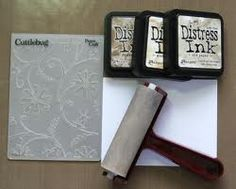 Using distress ink and embossing folders!