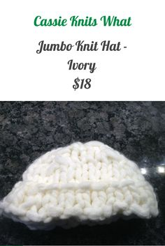This is an oversized, jumbo knit hat in ivory.