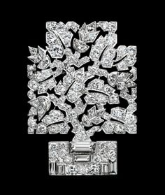 Platinum and diamond stylised tree in container or tub, the diamonds of different cuts - round, baguette, half moon etc. C. 1929, Mauboussin.