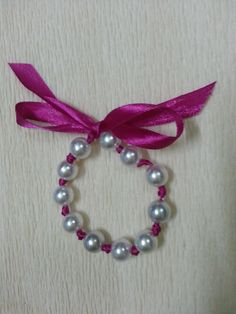 This is a lovey bracelet you can make for your bridal party. Match the ribbon with your theme color. They are affordable and simple to make. What you will need: Beads/pearls Ribbon Scissors Lighters or candles