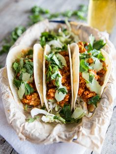 Spicy, saucy tacos made with a quick chipotle enchilada sauce, scrambled extra firm tofu, and a smooth and tangy cilantro cream!