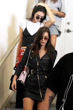 After the fall: Bella looked morose while exiting the show with good friend Kendall Jenner