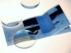 palm sized magnifier, made of acrylic by using CNC cutting machine. designed by Ichello Harada.