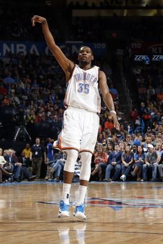 Oklahoma City's Kevin Durant (35) watches his shot go in during the NBA basketball game between the Oklahoma City Thunder and the Utah Jazz at the Chesapeake Energy Arena in Oklahoma City, Friday, Jan. 9, 2015. Photo by Sarah Phipps, The Oklahoman