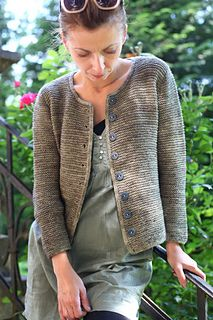 Order of the Garter is a very simple top-down, seamless cardigan. It is knit in garter stitch and the I-cord edgings are the only decorations of this minimalistic design. The texture of the garter stitch reminds me of a chain mail.