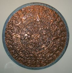 Mayan Day Counter, Phyllis Latham Stoner, copper artist, 1972  (Hand-tooled copper sections on round of wood)