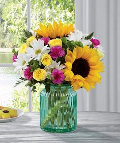 Giftblooms proudly presents the Better Homes and Gardens Sunlit Meadows Bouquet. Presented in an aqua blue designer glass vase, this mixed flower bouquet will make an excellent birthday, thank you, or get well gift. Unique Flower Arrangements, Unique Flowers, Beautiful Flowers, Floral Centerpieces, Father's Day Flowers, Spring Flowers, Send Flowers, Cut Flowers, Fresh Flowers