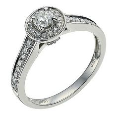 This extravagant 1/2 carat diamond ring features a glistening solitaire centre surrounded by an elegant halo. Set on a lustrous palladium 950 ring, diamond set shoulders add the final finishing touch of sparkle.