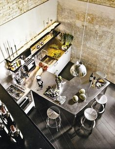 Industrial Chic Kitchen By Bernard (The WALL ...!!! Looks like concrete - I'll need to reproduce in paint!)