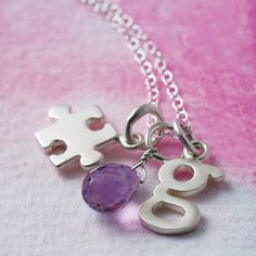 Jigsaw charm pieces can be added to the bracelet? Personalise them or simpley collect blank ones in numbers (Lily Charmed, 2014)