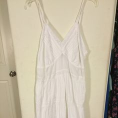 Subtle luxury white tank dress This is a really cute white cotton dress tank with lace . More of a medium length ! Super cute for summer with booties or wedges! More of a free people vibe but not from free people! Bought it in a boutique that carries free people clothing !:) Free People Dresses Midi