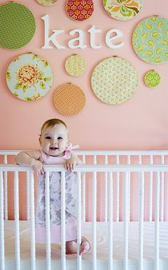 DIY nursery wall using embroidery hoops and fabric. ....love!