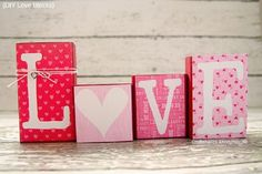 Love Block Valentine Decor. -Made with boxes, covered in colorful tissue paper and painted