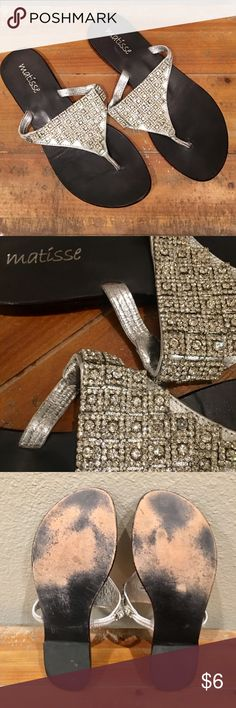 Matisse Silver And Bling Sandals Size 8 I love Matisse. My favorite brand of shoes. High quality and killer not so basic style👌🏼 Here's a pair of blinged out sandals by then. Great with jeans or dressing up any outfit when you want to change out of heels. Wear shows on the footbed which is covered when wearing them and it's just wrinkling from waking in them. True size 8. Matisse Shoes Sandals
