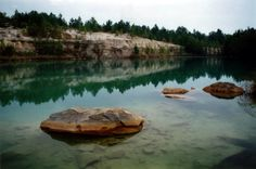 Blue Lagoon (Huntsville)- While this beautiful swimming hole lined by limestone rocks and towering pine trees caters to divers first, swimmers are just as welcome here. You can learn to dive among the small fish that have also made a home here, or just simply relax in the crystal-clear blue waters and enjoy nature.