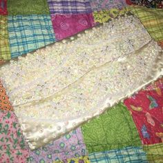 Antique beaded purse Silky ivory material with white beads & iridescent sequins. Some sequins and tearing in the back. Bags Clutches & Wristlets
