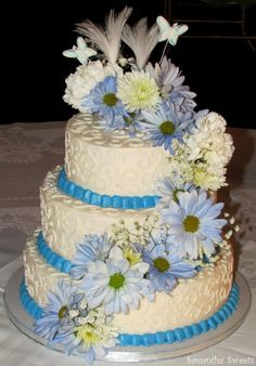 Blue & White Wedding Cake with real flowers by Samantha's Sweets