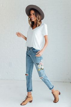 DETAILS: - Distressed jean with embroidered detailing - Runs Small - Small = Size 0-2 - Medium = Size 2-4 - Large = Size 4-6 - Model is wearing size S MEASUREMENTS: - Hip(Cm): S: 100cm, M: 103cm, L:10
