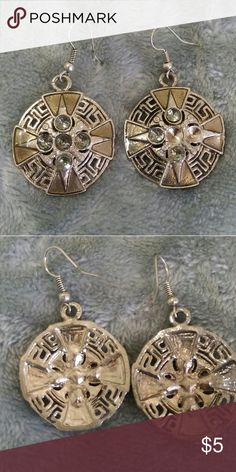 Silver and blue tribal earrings These silver and blue trival earrings have barely been worn. One earring is missing two stone but you cant notice it unless you get close since the hole shines too. Jewelry Earrings