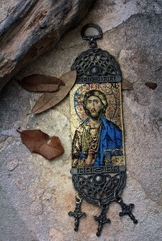 """Greek Orthodox Relic  Vintage Russian Greek Orthodox woven relic with gold threads, metal filigree work, three crucifixes and a ring for hanging. The icon is Christ Pantocrator."""
