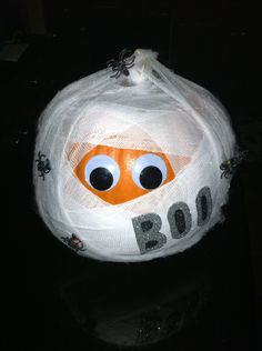 1st annual pumpkin decorating contest: Spooky mummy with glow in the dark spiders from Bacliff Dental.