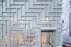 Coach's ninth and newest flagship location is in Tokyo, Japan. Designed by OMA architects, the modular building explores spatial possibilities with its coordination of vertical and horizontal framework, frosted glass shelving and expanse floor space.