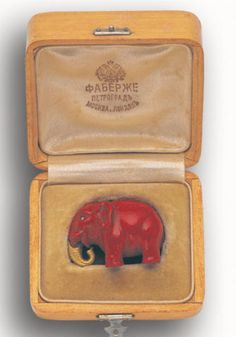 A miniature purpurine carving of an elephant, by Fabergé, circa 1900, FOOTNOTES The deep crimson vitreous material purpurine, was exclusive to the Fabergé workshops and frequently used in their animal carvings. It was made by introducing lead chromate into a glass matrix, a technique initially used in Italy during the 18th century and rediscovered by the Imperial Glass Factory in St Petersburg.
