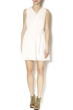 Sleeveless faux wrap dress with ruched shoulders, modesty snap front, embroidered scallop details on piping and pockets and a back neck tie